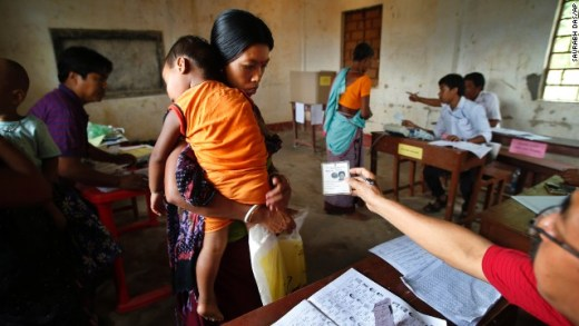 An official checks a voter's identity card in Agartala, India, on Monday, April 7. India's general election will be held in stages over five weeks. Voters will elect 543 members to the lower house of parliament, which will then select the country's next prime minister. Prime Minister Manmohan Singh is stepping aside after a decade in charge.