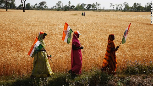 Congress party supporters hold flags as they walk home after attending a rally for Rahul Gandhi in the northern state of Uttar Pradesh on Saturday, April 12. India's general election is being held in stages over five weeks. Voters will elect 543 members to the lower house of parliament, which will then select the country's next prime minister. Prime Minister Manmohan Singh is stepping aside after a decade in charge.