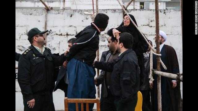 Maryam Hosseinzadeh, standing on a chair, slaps Balal.