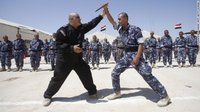 Newly recruited Iraqi volunteer fighters take part in a training session in Karbala, Iraq, on June 17.