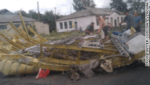 Wreckage thought to be from Malaysia Airlines Flight 17 lies in Ukraine on Thursday. This image was posted to Twitter.