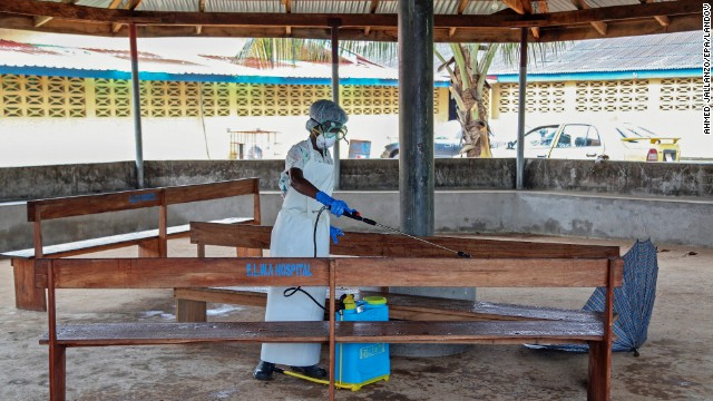 A nurse disinfects the waiting area at the ELWA Hospital in Monrovia on Monday, July 28.