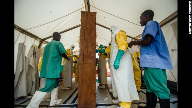 Doctors Without Borders staff prepare to enter the isolation ward at an Ebola treatment center in Kailahun on July 17.