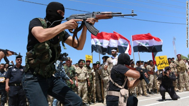 Iraqi Shiite volunteers who have joined government forces to fight ISIS take part in a training session near Basra, Iraq, on Thursday, August 7.