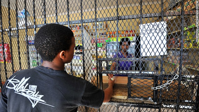 "Johannesburg may be ""one of the most beautiful cities in the world"" says Conde Nast Traveler, but that's not enough to counter the ""crime and contrasts"" (illustrated by this shopkeeper separated from customers by a security barrier) that earned it the title of least friendly in the magazine's annual list."