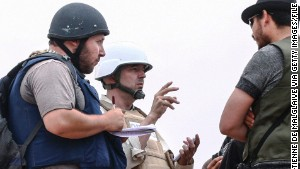 Steven Sotloff, far left, speaks with rebels in Misrata, Libya, in June 2011.