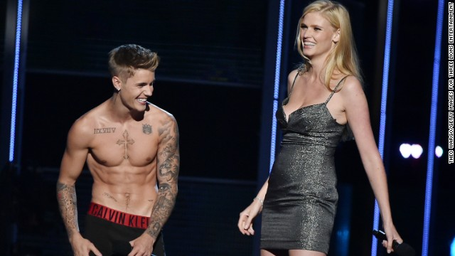 "Justin Bieber is a documented fan of public shirtlessness and <a href='http://www.mtv.com/news/1712168/justin-bieber-sings-naked-grandmother/' target='_blank'>singing songs to his grandmother in the nude</a>. We can now also call the ""Baby"" singer a fan of the public striptease. At the charity event ""Fashion Rocks,"" Bieber removed everything but his underwear right on stage with co-presenter Lara Stone, explaining that he just didn't feel comfortable unless he was in his ""Calvins."""