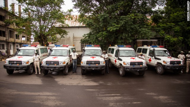 Five ambulances that were donated by the United States to help combat the Ebola virus are lined up in Freetown on September 10 following a ceremony that was attended by Sierra Leone President Ernest Bai Koroma.
