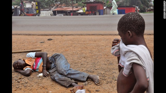 A child stops to look at a man who is suspected of suffering from the Ebola virus on a main street in Monrovia, Liberia, on Friday, September 12. Health officials say the current Ebola outbreak in West Africa is the deadliest ever. More than 4,700 cases have been reported since December, with more than 2,400 of them ending in fatalities, according to the World Health Organization.