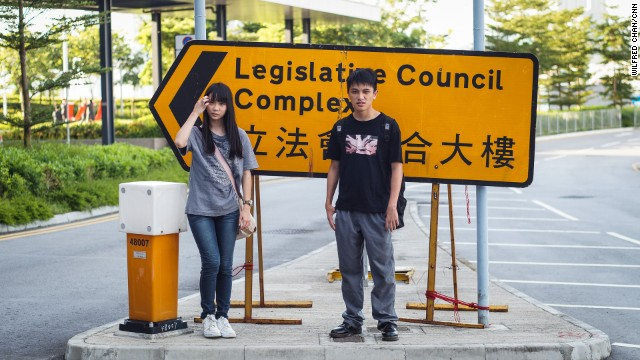 """17-year-old students Agnes Chow and Ivan Tan are members of Scholarism. """"After joining Scholarism, I've become braver than before,"""" Chow told CNN last year."""