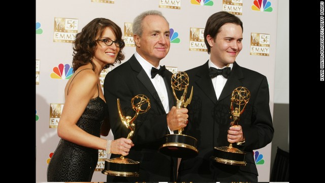 Tina Fey, Lorne Michaels (center) and Dennis McNicholas pose with Emmys in 2002.