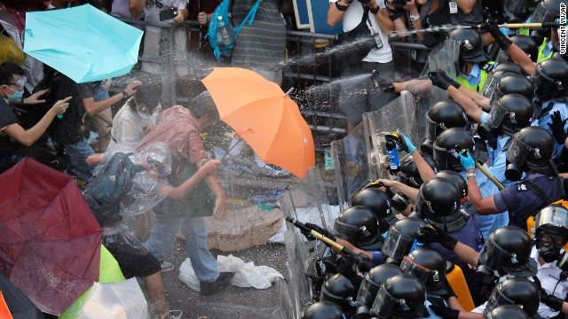 Police and protesters clash during a tense standoff with thousands of student demonstrators, recently joined by the like-minded Occupy Central movement, on September 28.