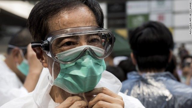 Pro-democracy activist and former legislator Martin Lee wears goggles and a mask to protect against pepper spray on September 28.