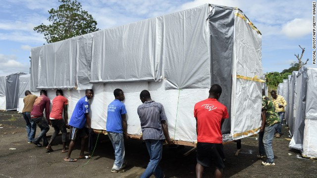 Workers move a building into place as part of a new Ebola treatment center in Monrovia on September 28.