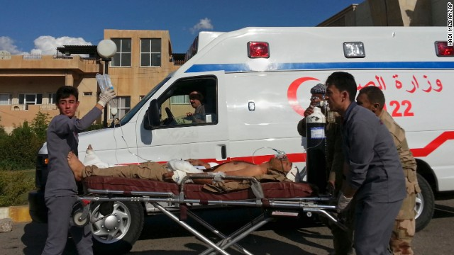 A Kurdish Peshmerga soldier who was wounded in a battle with ISIS is wheeled to the Zakho Emergency Hospital in Duhuk on Tuesday, September 30.