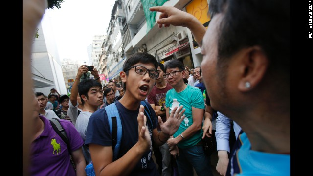 A protester tries to negotiate with angry residents trying to remove barricades blocking streets in Hong Kong's Causeway Bay on October 3. Large crowds opposed to the pro-democracy movement gathered to clear the area.
