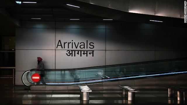 A man moves down the escalator at the arrivals section of the Indira Gandhi International Airport in New Delhi on Wednesday, November 19. A 26-year-old Indian man who recovered from Ebola in Liberia has been placed in isolation at the New Delhi airport after traces of the virus were found in his semen, according to India's Health Ministry. Health officials say the Ebola outbreak in West Africa is the deadliest ever. More than 5,400 people have died there, <a href='http://www.who.int/csr/disease/ebola/situation-reports/en/' target='_blank'>according to the World Health Organization.</a>