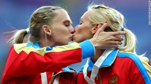 Russian runners kiss on the winners podium at competition ...