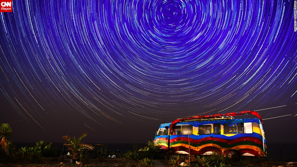 """<a href=""""http://ireport.cnn.com/docs/DOC-1149431"""" target=""""_blank"""">Gokhan Saymaz</a> is a part-time professional photographer. He created this dazzling image of star trails above Esentepe, in Cyprus. Saymaz used a long exposure technique, shooting 111 frames with a shutter speed of 30 seconds for each frame, before combining them using star trails software."""
