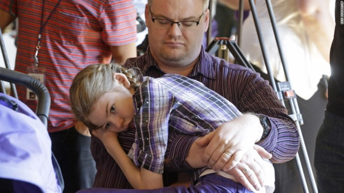Marshall Christensen holds his daughter Jessica, who has a severe form of epilepsy known as Dravet Syndrome.