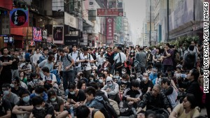 Pro-democracy protesters stand their ground in the financial district of Hong Kong on October 17, 2014.