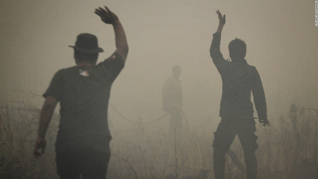 Indonesian firefighters put out a fire on smoldering peatland in Siak Regency located in Riau province on Indonesia's Sumatra island, March 1, 2014.