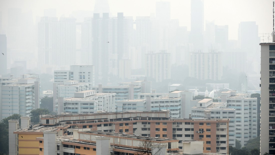 Singapore's financial business district covered with smog, on September 15, 2014. Offcials said air pollution hit unhealthy levels due to smog from fires raging across rainforests in Indonesia's neigboring Sumatara island.