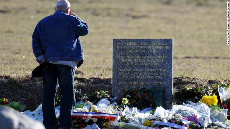 A man stands in front of a commemorative headstone in Seyne-les-Alpes, the closest accessible site to where a Germanwings Airbus A320 crashed last week in the French Alps, killing all 150 people on board.