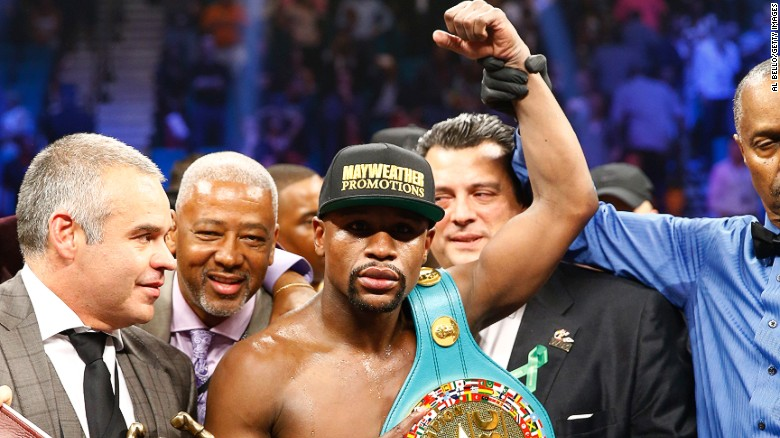 Floyd Mayweather Jr. celebrates victory after the MGM clash.