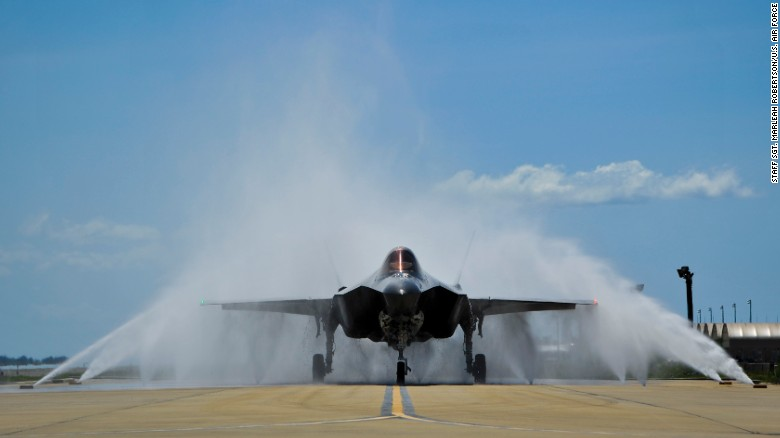 "Lt. Col. Christine Mau navigates her F-35A through the ""bird bath"" after returning from her first flight on Eglin Air Force Base, Florida, on Tuesday."