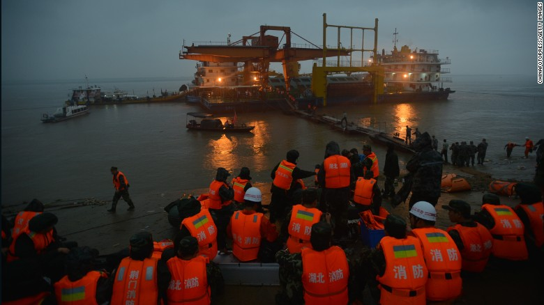 Rescuers search for survivors from the capsized ship in the Yangtze River in Jingzhou on June 2.