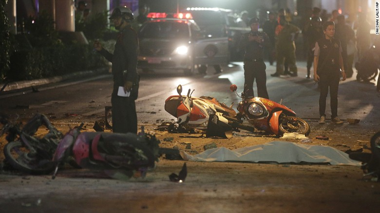 Motorcycles and debris lie on the pavement after an explosion in Bangkok, Thailand, killed at least 22 people.