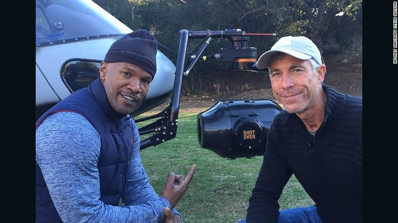 Pilot Alan Purwin, on right, seen here with actor Jamie Foxx, died in a plane crash in Colombia after the shooting of a Tom Cruise movie