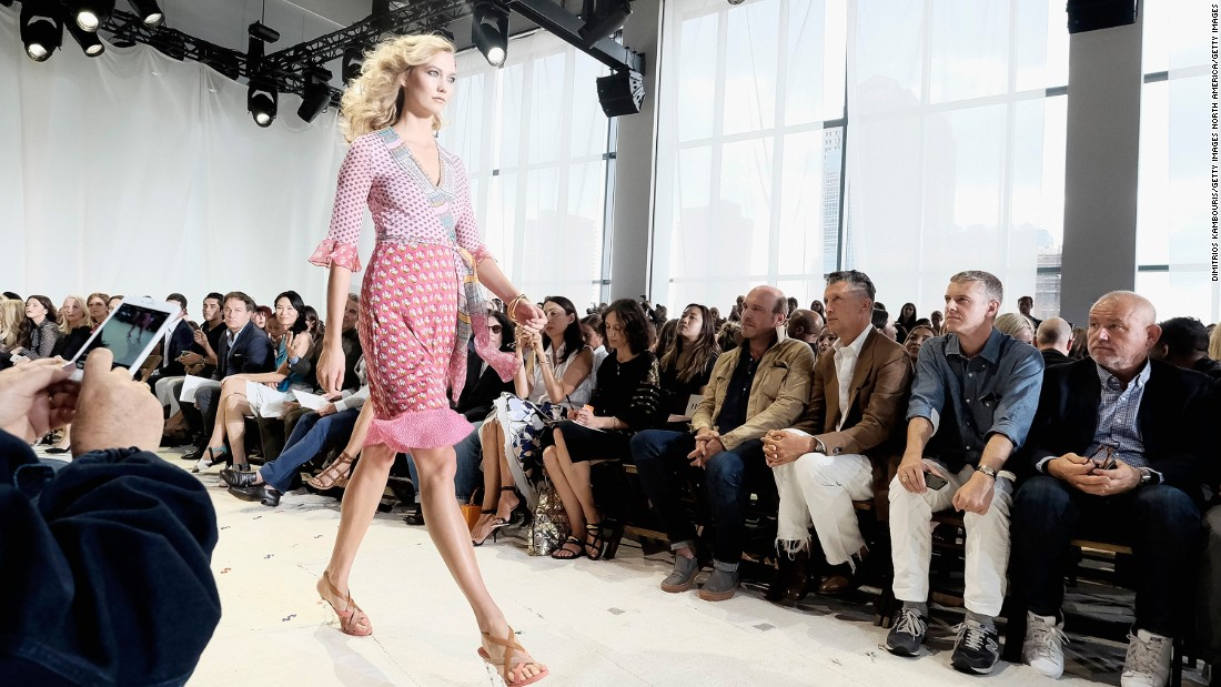 Model Karlie Kloss walks the runway in a DVF signature wrap dress.