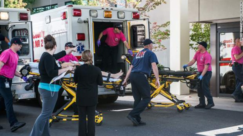 A patient is wheeled into the emergency room at Mercy Medical Center in Roseburg, Oregon, following a deadly shooting at Umpqua Community College on Thursday, October 1. Preliminary information indicated that 10 people were killed and more than 20 were injured, police said. Douglas County Commissioner Chris Boice told CNN that the shooter is in custody.