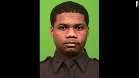Officer Randolph Holder, 33, was shot in the head.