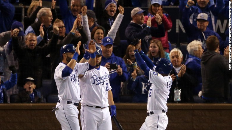 The Kansas City Royals' Alex Rios, left; Kendrys Morales, center; and Alcides Escobar celebrate after scoring runs in the fifth inning Game 2 of the World Series against the New York Mets at Kauffman Stadium in Kansas City, Missouri, on Wednesday, October 28.