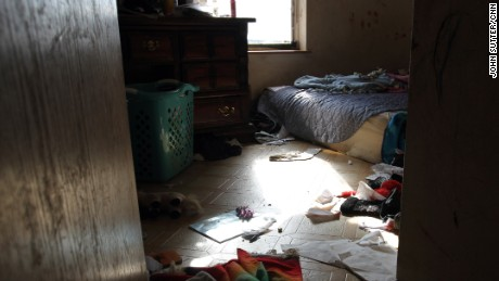 Willamette Rising Sun's home in Lame Deer, Montana, doesn't have electricity. The family has huddled together in this room for warmth.