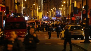 Police forces, firefighters and rescue workers secure the area near the Bataclan concert hall in central Paris, early on Saturday, November 14, following a string of attacks. Scores of people are reported dead after what are being called terror attacks across Paris, on Friday, November 13, including shootings and explosions at the Stade de France, just north of Paris.