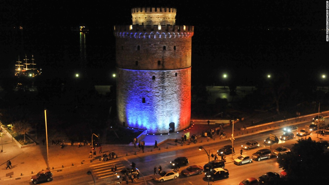 The White Tower, symbol of the city of Thessaloniki in Greece, is lit with the colors of the French national flag on November 14.