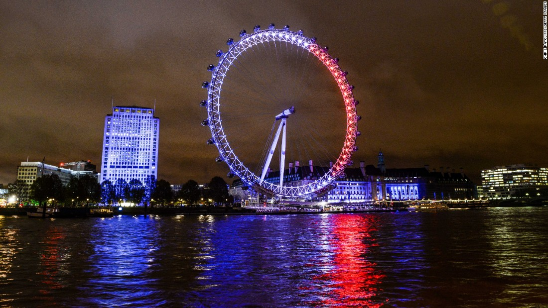 The London Eye reflects onto the River Thames on November 14 in London.