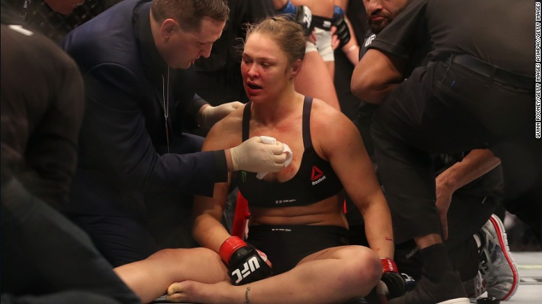 Ronda Rousey receives medical treatment after being defeated by Holly Holm on November 15.