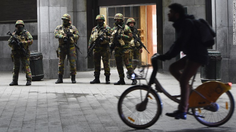 Soldiers stand guard in front of the Brussels Central Train Station on November 22, 2015 as the Belgian capital remained on the highest security alert level over fears of a Paris-style attack.     AFP PHOTO / Emmanuel Dunand        (Photo credit should read EMMANUEL DUNAND/AFP/Getty Images)