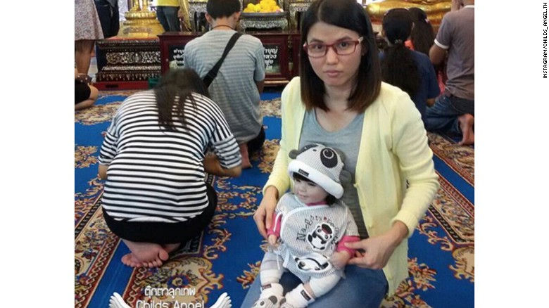 """A Luk Thep doll (spirit doll) is treated as a real child by its adopted """"parent"""" and can cost as much as $362."""