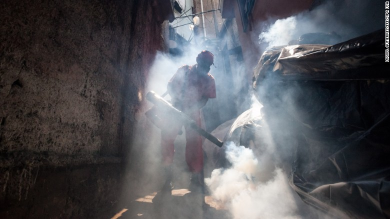 """A health worker fumigates an area in Caracas, Venezuela, to combat the Aedes aegypti mosquito on Tuesday, February 2. The mosquito carries the <a href=""""http://www.cnn.com/specials/health/zika"""" target=""""_blank"""">Zika virus,</a> which has suspected links to birth defects in newborn children. The World Health Organization expects the Zika outbreak to spread to <a href=""""http://www.cnn.com/2016/01/25/health/who-zika-virus-americas/index.html"""" target=""""_blank"""">almost every country in the Americas.</a>"""