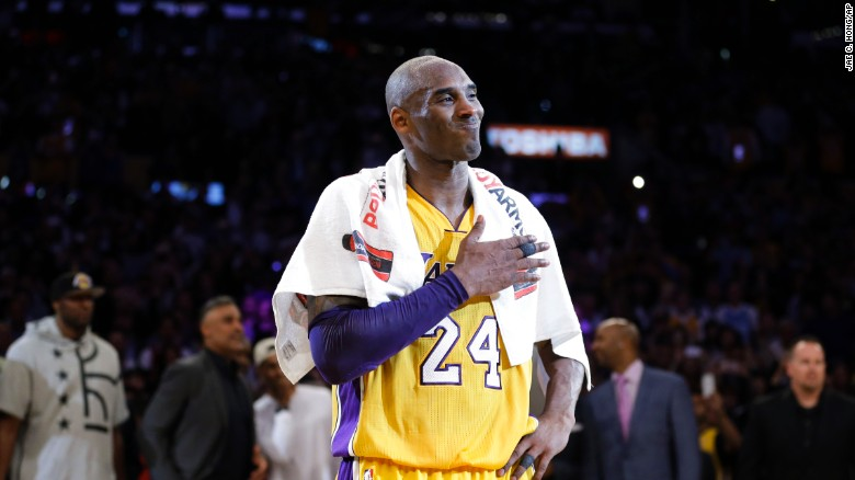 Kobe Bryant pounds his chest after the last NBA basketball game of his career, against the Utah Jazz on Wednesday, April 13, 2016.