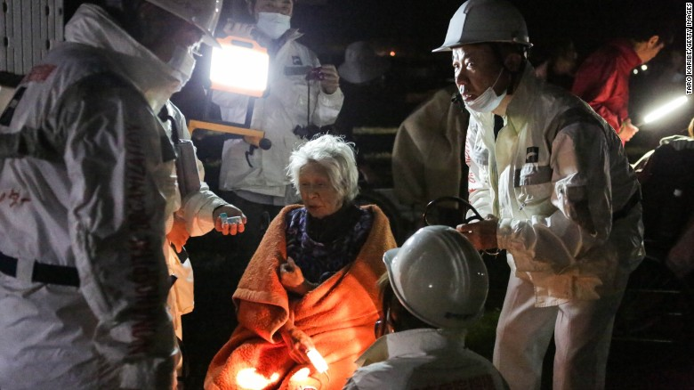 "Rescue workers take care of a woman suffering from shock after a 7.0 magnitude earthquake at the evacuation center at the Mashiki Town Gymnasium on Saturday, April 16, in Kumamoto, Japan. <a href=""http://www.cnn.com/2016/04/15/asia/japan-earthquake/index.html"" target=""_blank"">The latest earthquake</a> struck early Saturday on Kyushu island, the same region hit by a <a href=""http://www.cnn.com/2016/04/14/asia/japan-earthquake/"" target=""_blank"">magnitude-6.2 earthquake</a> two days earlier."