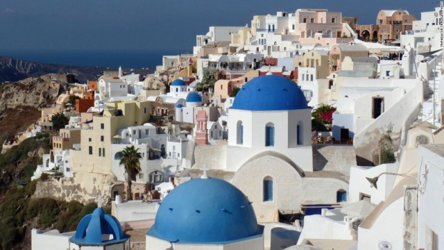 The Greek island of Santorini, the remains of an exploded volcano in the Aegean Sea, has black sand beaches and picturesque villages.