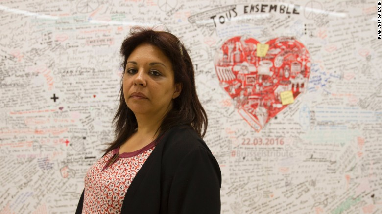 Saliha Ben Ali at the mural at Maalbeek metro station honoring the victims of the Brussels terror attacks on March 22.