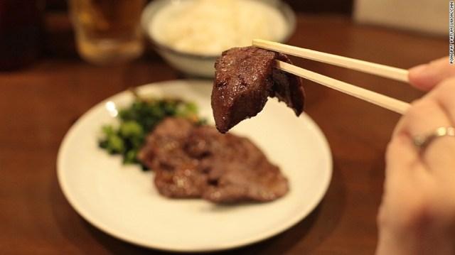A slice of Aji Tasuke's perfectly seasoned beef tongue.